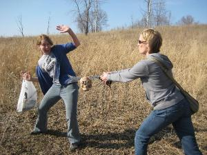 Maggie and Kristen fight with the cache during the NerdHerders innagural geocache trip.